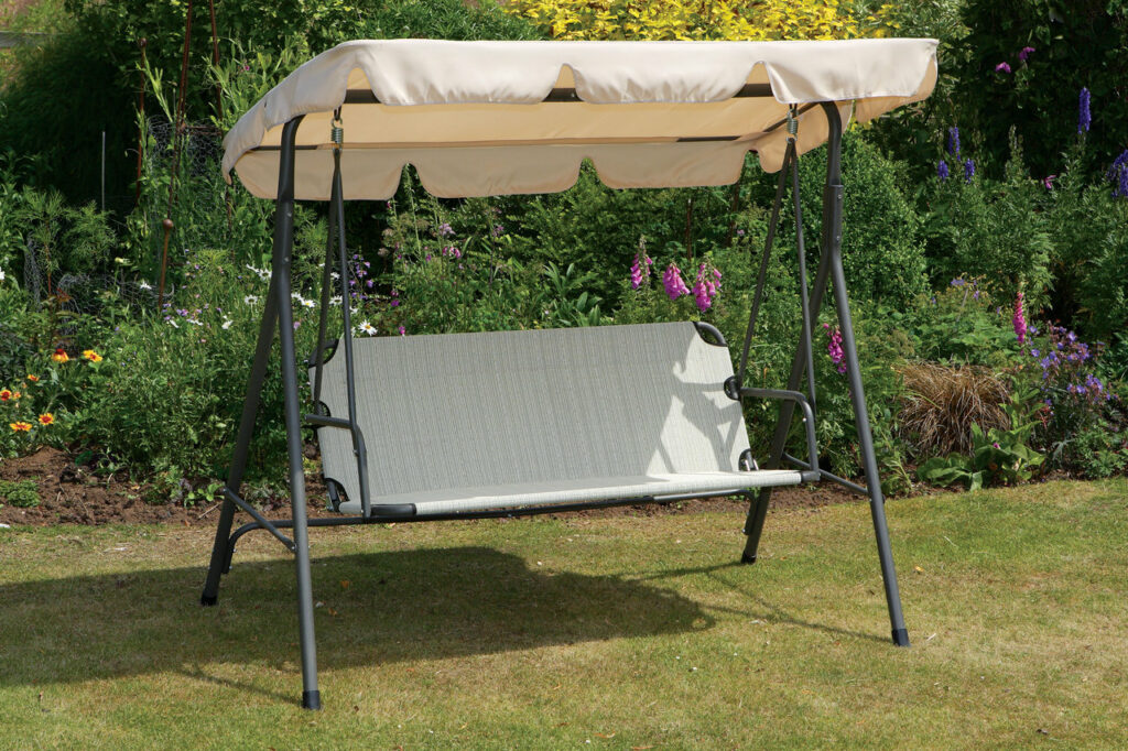 beautiful garden swing with a canopy
